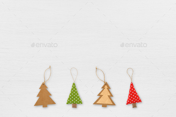 Christmas tree decorations on white wooden table - Stock Photo - Images