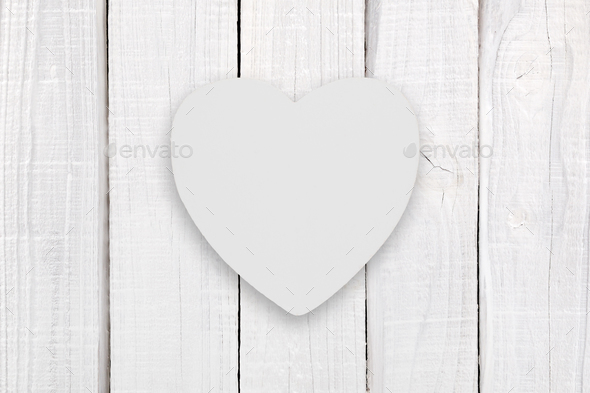 Blank white wooden heart on white wooden background - Stock Photo - Images