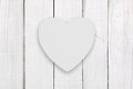 Blank white wooden heart on white wooden background - PhotoDune Item for Sale