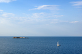 Seascape with sailing yacht and small island in sea - PhotoDune Item for Sale