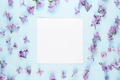 Blank greeting card and lilac flowers on blue background - PhotoDune Item for Sale