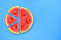 Watermelon slices on blue table top view - PhotoDune Item for Sale