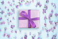Gift box and lilac flowers on blue background - PhotoDune Item for Sale