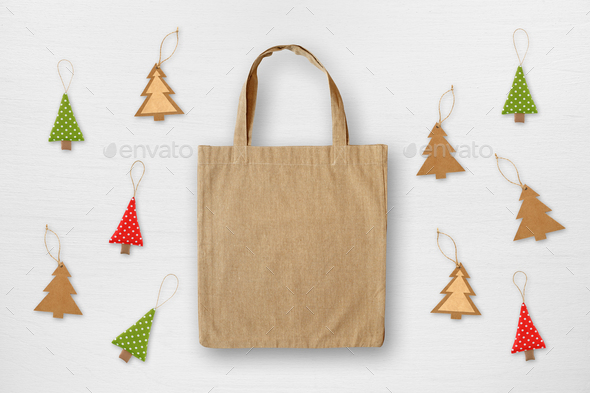 Canvas bag and handmade Christmas decorations on white wooden background. Christmas sale concept. - Stock Photo - Images