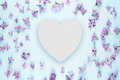 Blank white wooden heart and lilac flowers on blue background - PhotoDune Item for Sale