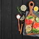 Bruschetta with salmon and fresh cucumber. Top view. - PhotoDune Item for Sale