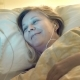 Before Falling Asleep a Woman Wishes a Good Night To a Loved One Via the Internet Using a Smartphone - VideoHive Item for Sale