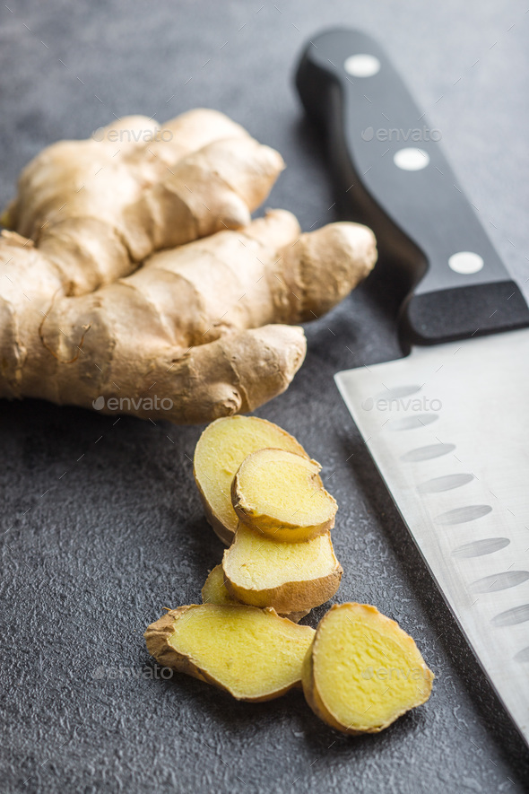 Sliced ginger root. - Stock Photo - Images