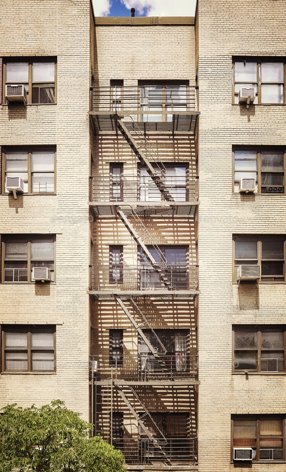 New York building with fire escape ladders, USA. - Stock Photo - Images