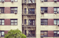 New York building with fire escape ladders, USA. - PhotoDune Item for Sale