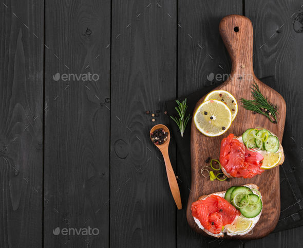 Bruschetta with salmon and fresh cucumber - Stock Photo - Images