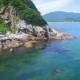 Drone Shoot Along the Rocky Coast on a Sunny Day - VideoHive Item for Sale