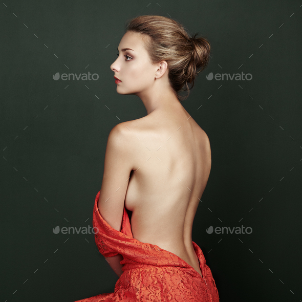 Fashion portrait of beautiful woman in elegant red dress - Stock Photo - Images