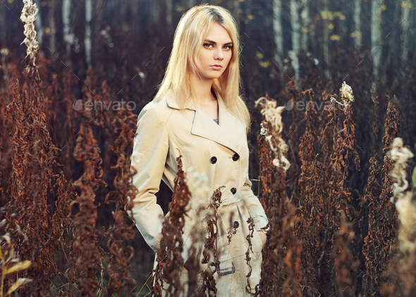 Portrait of young beautiful woman in autumn cloak - Stock Photo - Images