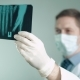 Doctor in Mask and Gloves Looks at X-ray - VideoHive Item for Sale