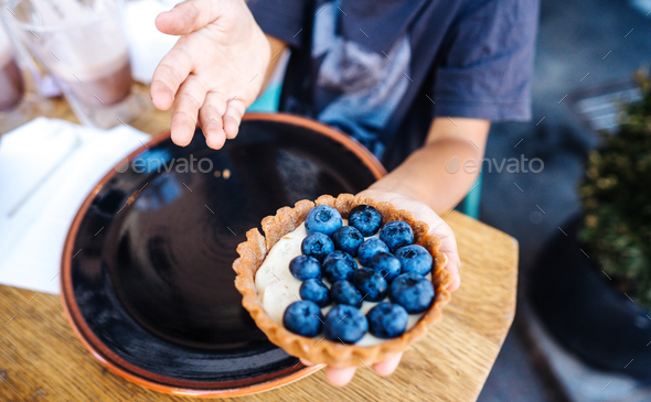 Dessert with blueberries in an edible basket - Stock Photo - Images