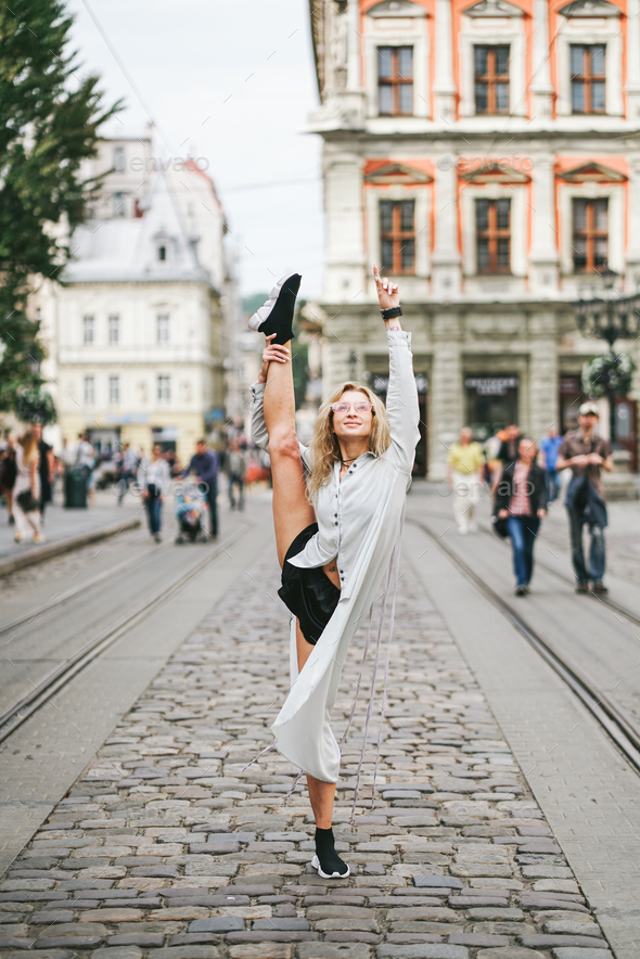 beautiful young girl lifted her leg up - Stock Photo - Images