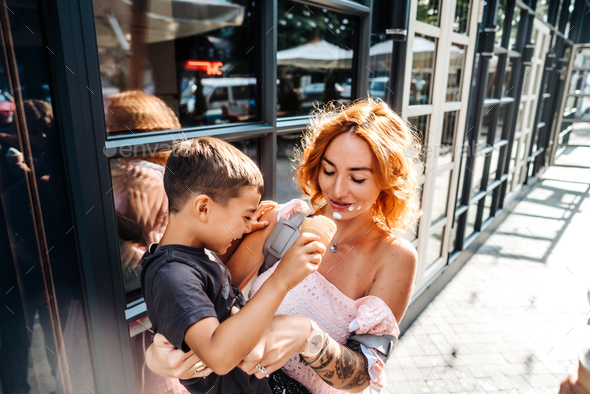 mom and son eat ice cream together - Stock Photo - Images