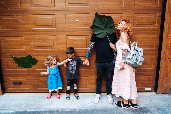 Family having fun on the street - Stock Photo - Images