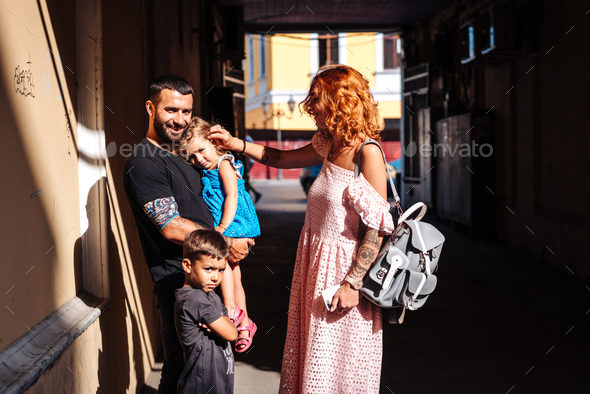 beautiful parents and their cute little kids - Stock Photo - Images