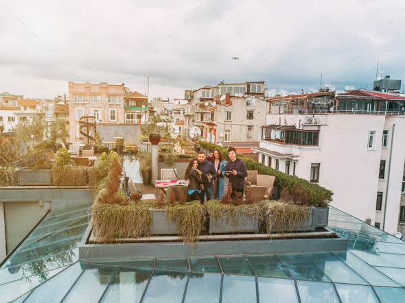 Friends on the Rooftop - Stock Photo - Images