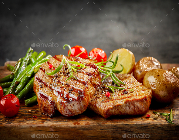 Grilled beef steaks - Stock Photo - Images