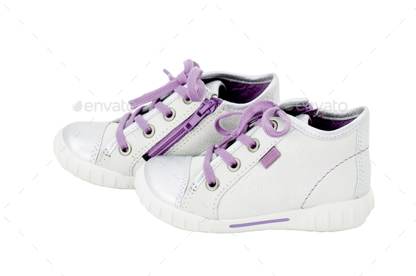 White leather sneakers with purple shoelace. - Stock Photo - Images