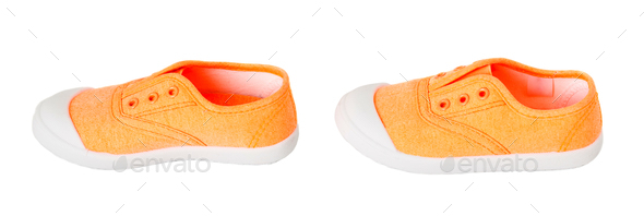 Baby girl orange fabric sneakers. - Stock Photo - Images