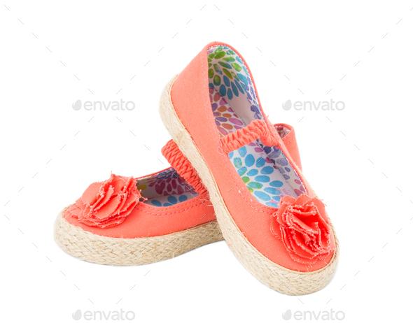 Baby girl orange fabric sneakers. - Stock Photo - Images
