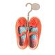 Baby girl orange sneakers on plastic hanger. - PhotoDune Item for Sale