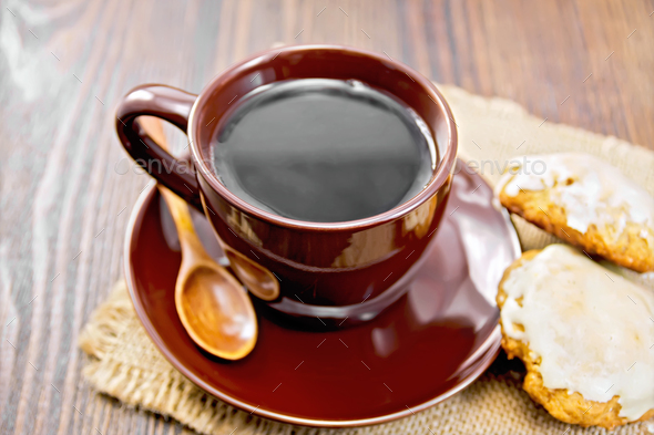 Coffee in brown cup with cookies on dark board - Stock Photo - Images
