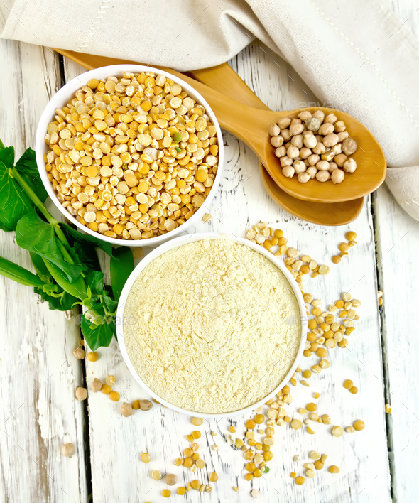 Flour pea and split pease in bowls on board top - Stock Photo - Images