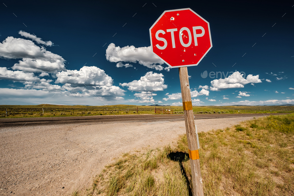 Stop sign on empty highway in Wyoming - Stock Photo - Images