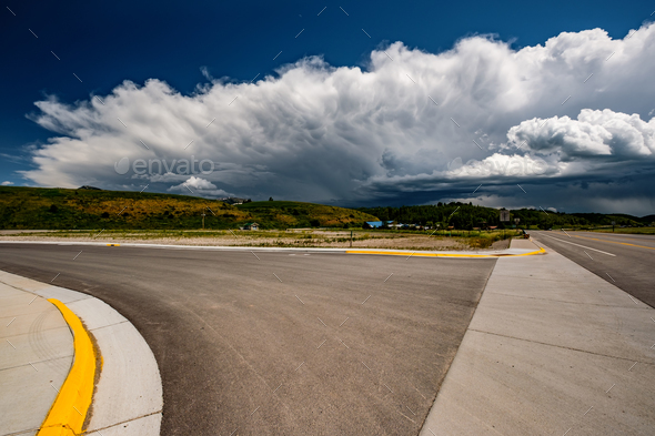 Empty open highway and stormy clouds in Wyoming - Stock Photo - Images
