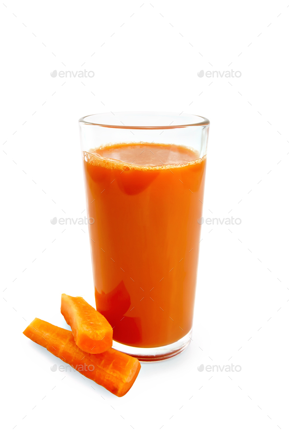 Juice carrot in tall glass with vegetables - Stock Photo - Images