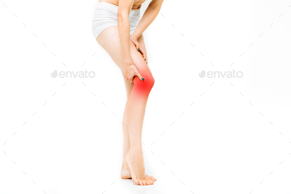 Joint ache, female person with leg stretching - Stock Photo - Images