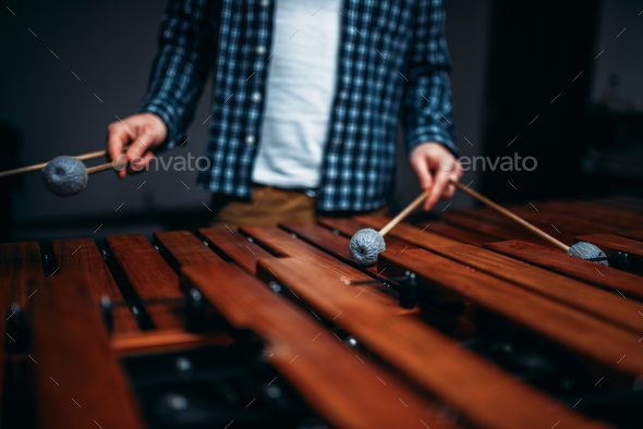 Xylophone player hands with sticks, wooden sounds - Stock Photo - Images