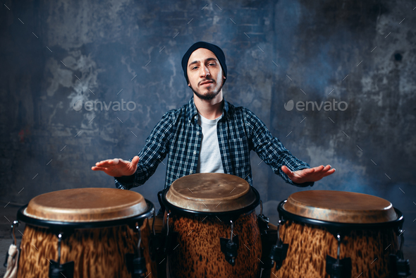 Drummer playing on wooden bongo drums, beat music - Stock Photo - Images