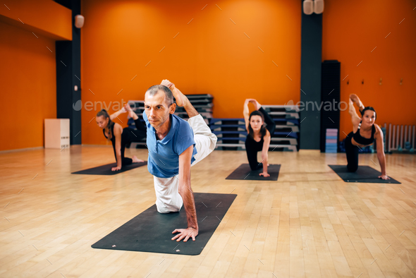 Yoga stretching training, group with instructor - Stock Photo - Images