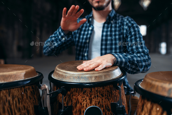 Drummer hands playing on wooden drum, closeup - Stock Photo - Images
