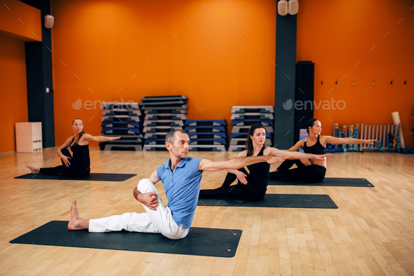 Yoga training class, female group workout - Stock Photo - Images