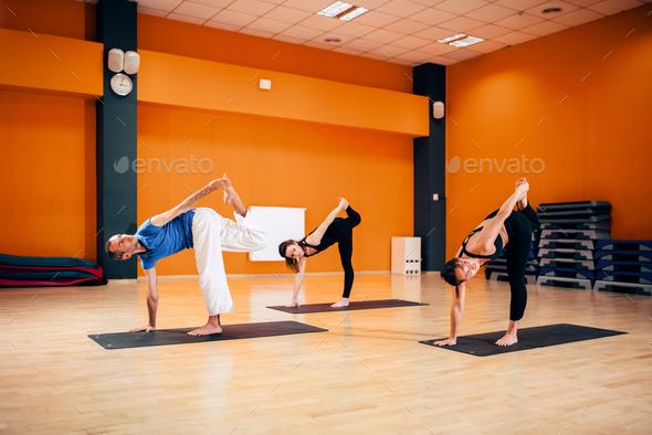 Balance exercise, female yoga group in action - Stock Photo - Images