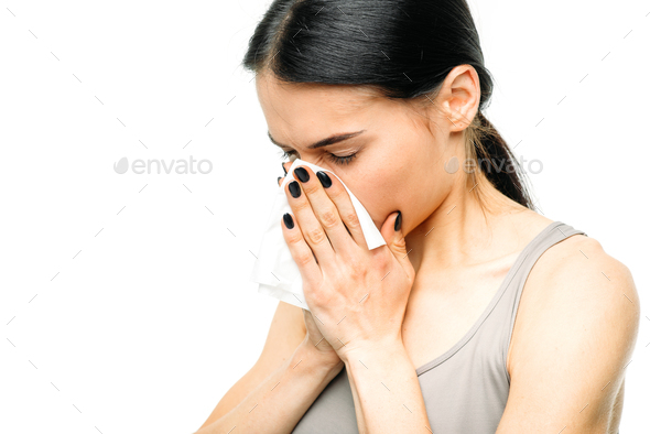 Painful woman with runny nose, snot or flu - Stock Photo - Images