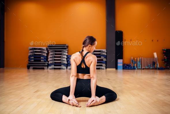 Yoga training, woman doing stretching exercise - Stock Photo - Images