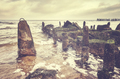 Retro toned picture of an old sea breakwater - PhotoDune Item for Sale