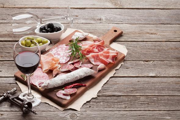 Salami, ham, sausage, prosciutto and wine - Stock Photo - Images