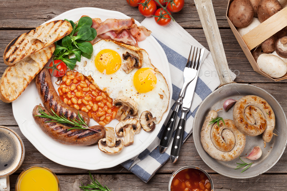 English breakfast. Fried eggs, sausages, bacon - Stock Photo - Images