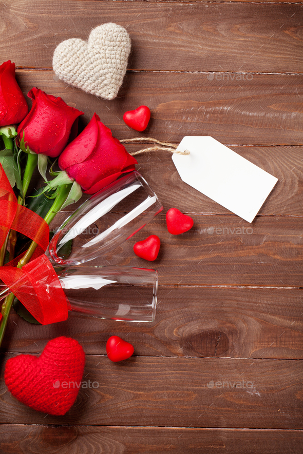 Valentines day roses bouquet and champagne glasses - Stock Photo - Images