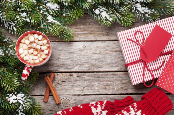 Christmas background with fir tree, gifts, hot chocolate - Stock Photo - Images