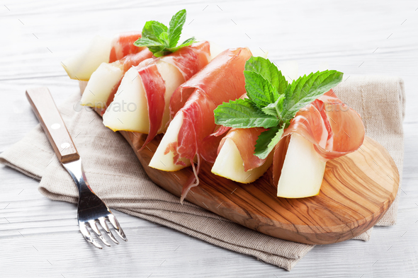 Fresh melon with prosciutto and mint - Stock Photo - Images